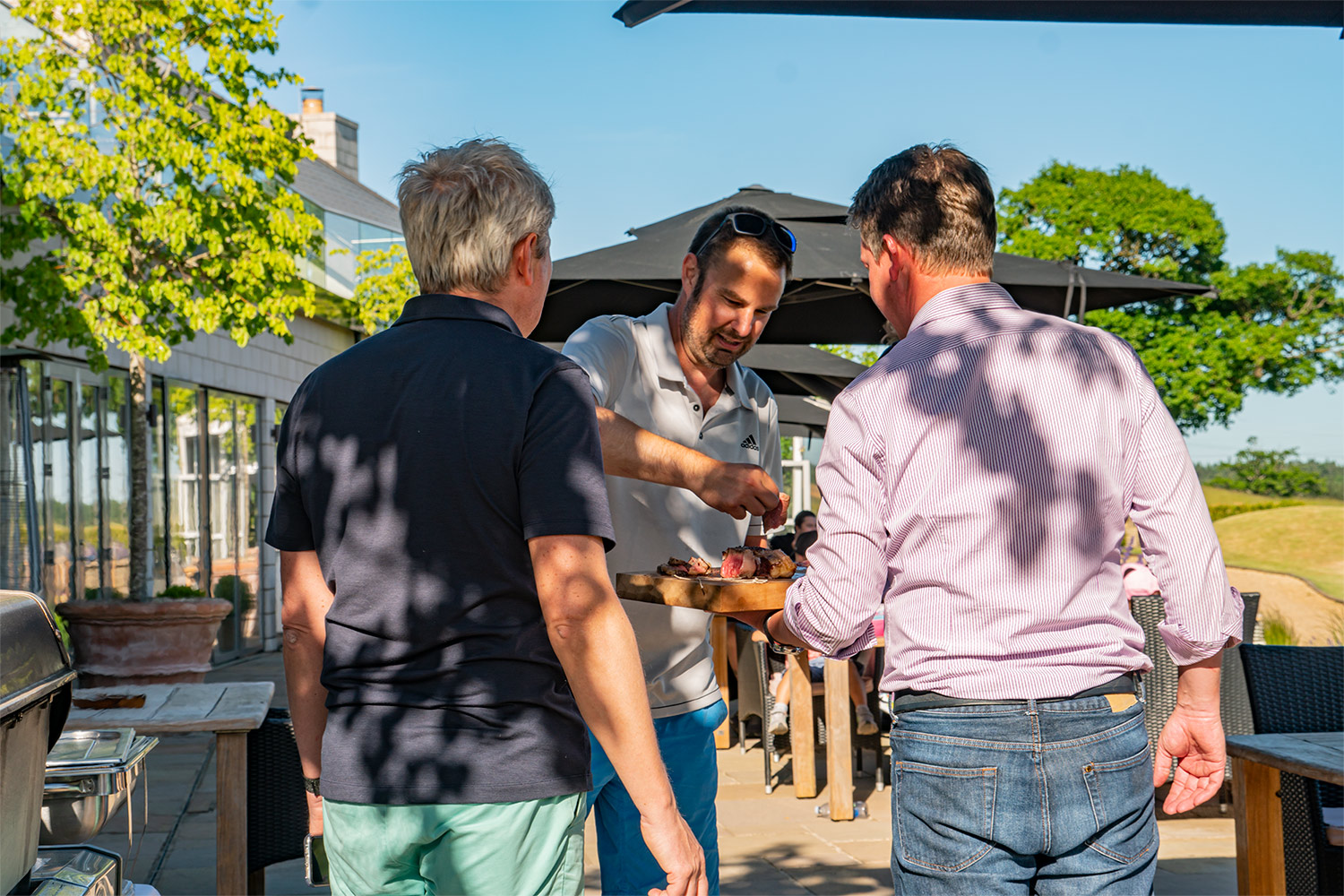 Serving steak from a Grillo Outdoor Kitchen