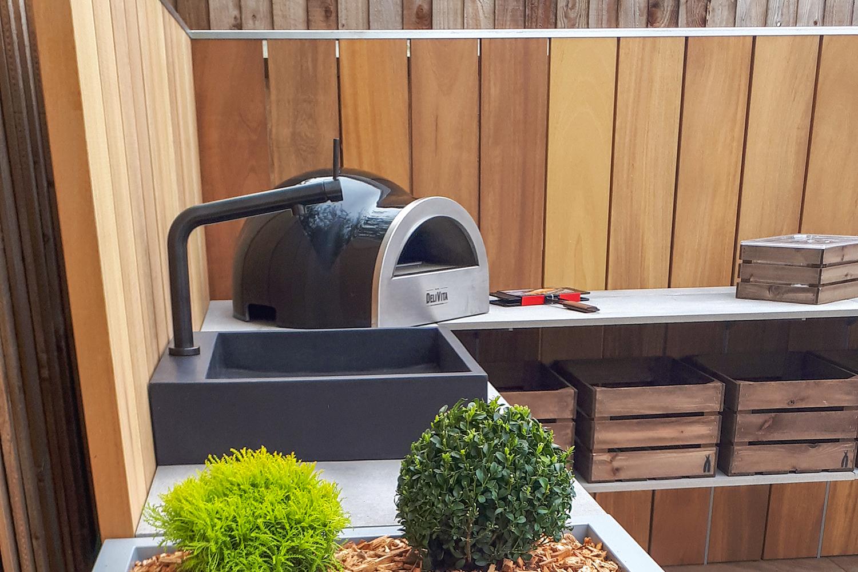 Grillo L shape kitchen with planters, sink, Delivita, storage crates, corner view closeup