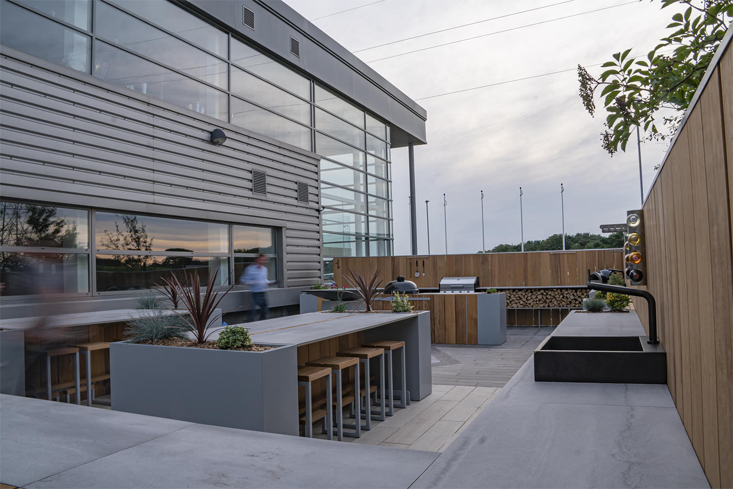 Havwoods Grillo outdoor kitchen project seating, Chef's Anvil BBQs pizza oven, sinks, double fridges work tops