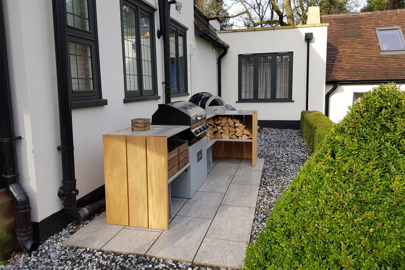 Grillo short L shaped kitchen with Delivita, Cadac, crates and logs
