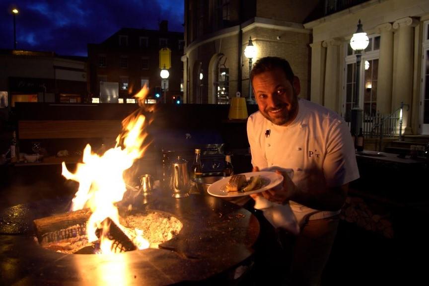 Outdoor Kitchen ideas chef tristian welch cooking in vantage kitchen around chef's anvil