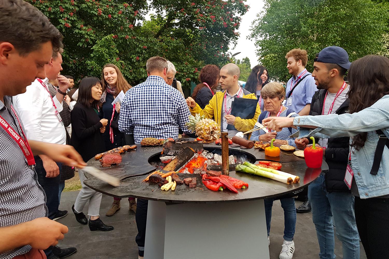 crowd around anvil food demo display