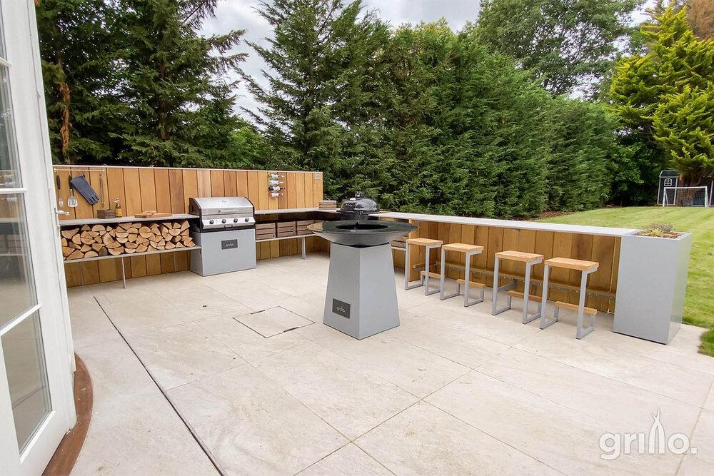 long Grillo L shaped kitchen, bar stools, anvil, Cadac, logs crates. planters