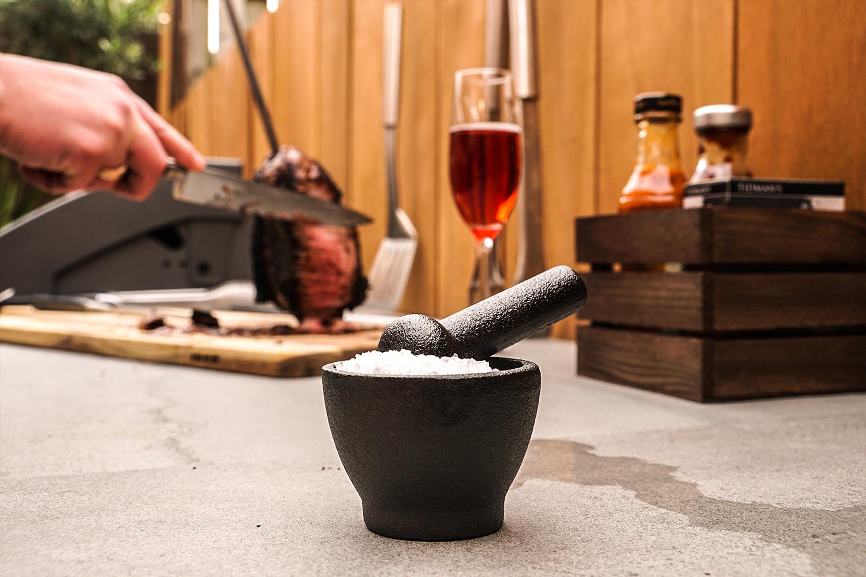 black stone Pestle and Mortar with white sea salt in Grillo Kitchen