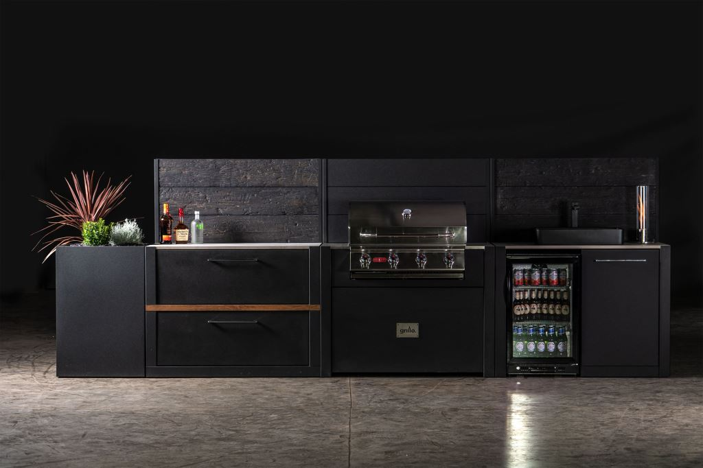 black carbon Steel Vantage Kitchen with Embered Back Panelling, incorporated gas barbeque, drink fridge, black stone sink and herbs planter