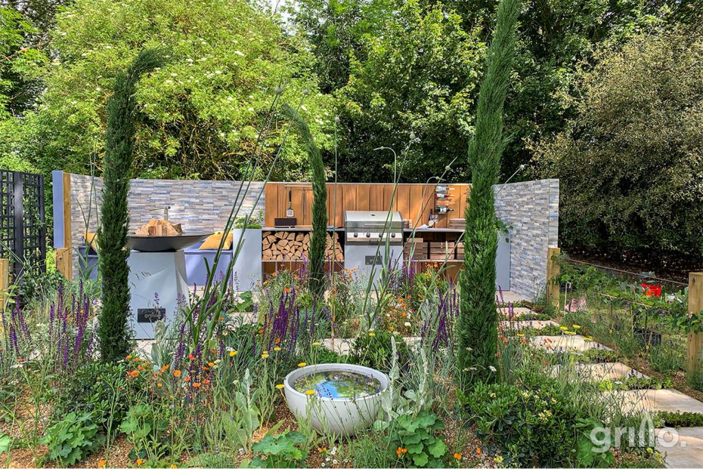 grillo forge straight run project with colourful plants and shrubs in front of kitchen