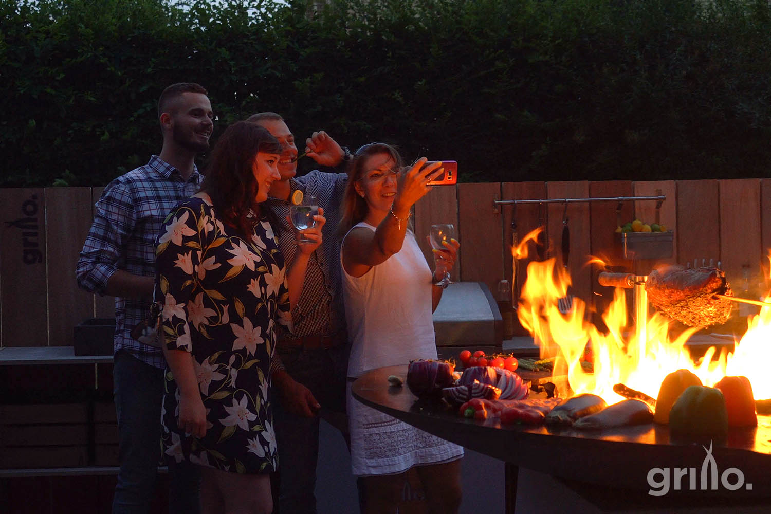 four people taking a selfie around Grillo Chefs Anvil